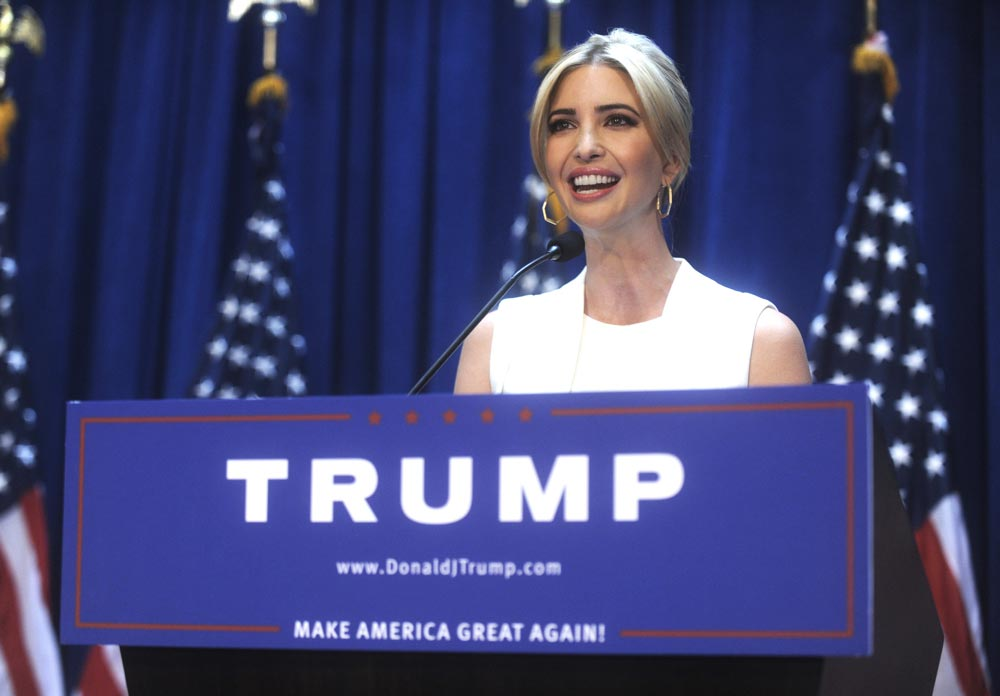 Ivanka Trump behind podium of Donald Trump Presidency announcement Make America Great Again banner is displayed on podium